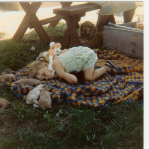 Nicole as a child, with puppies.