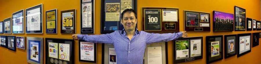 Philip Maung with winning awards in the City of Charlotte
