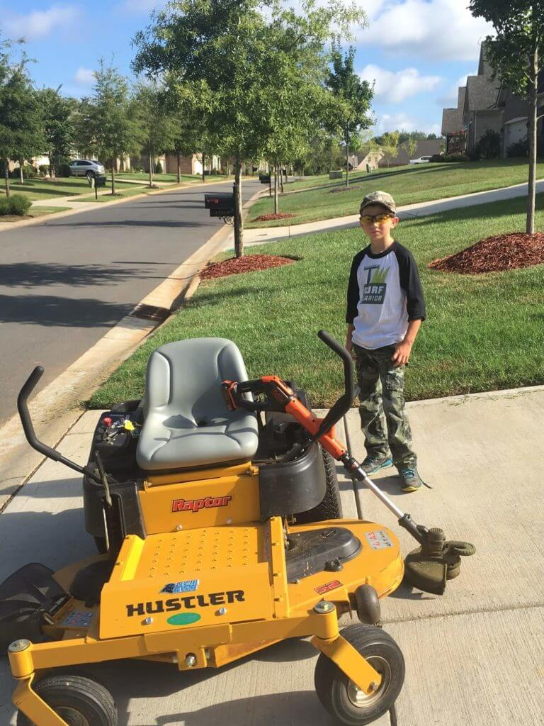 Charlotte Business Resources  meets young entrepreneur, Ryan Kirsch with the mower