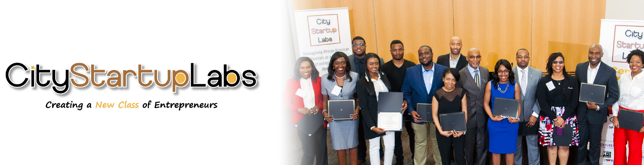 City Startup Labs logo with African American professional posing for group photo