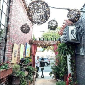 Outside alleyway with hanging lanterns of Magnolia Emporium
